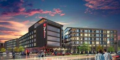 A hotel and apartment building are planned for downtown's Park East strip. The initial planned Radisson brand is being changed.