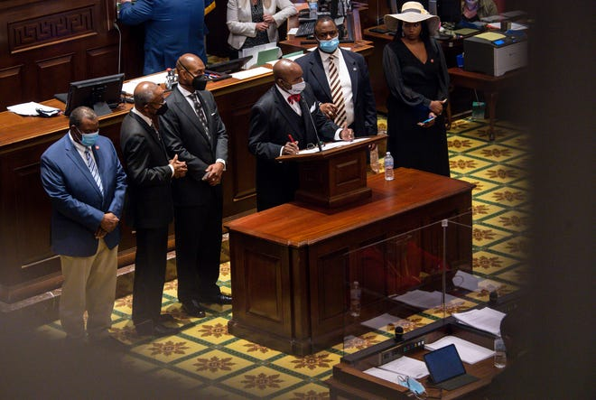 G.A. Hardaway and members of the Black Caucus present a resolution to honor Rev. William Barber at the end of the legislative session in the Tennessee House of Representatives in Nashville, Tenn., on Wednesday, May 5, 2021. The resolution failed after members of the house.
