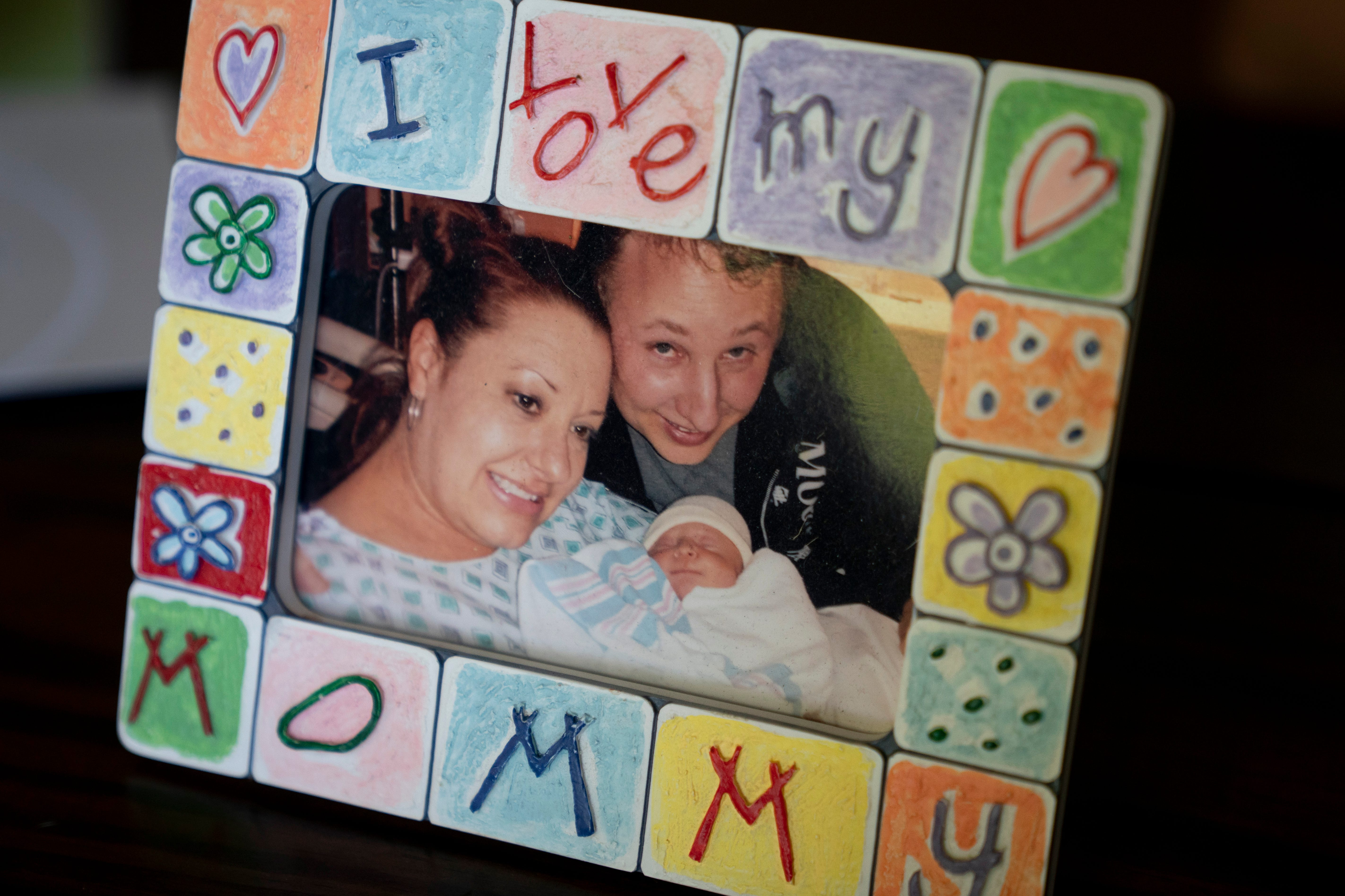 """A framed picture from the day Eli was born sits on the table at the Valimonts' home in North Naples on Tuesday, May 4, 2021. Gay and Brian were told they had a 1-3% chance of conceiving and didn't expect to get pregnant. The feeling of holding Eli in their arms for the first time was """"amazing,"""" Gay said."""