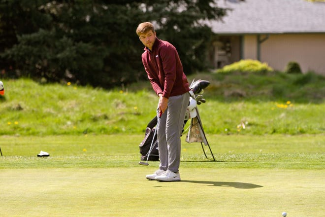 New Mexico State sophomore Garrison Smith watches the ball after a put on the green during the Western Athletic Conference Championship at Boulder Creek Golf Club in Boulder City, Nevada, on April 30, 2021.