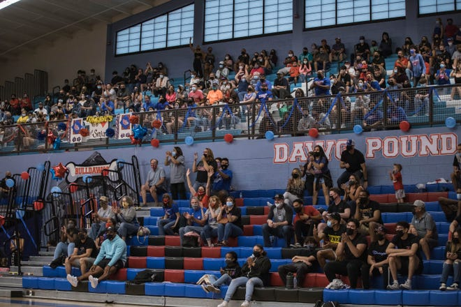 Fans are let in to watch the Las Cruces Bulldawgs face off against the Los Lunas Tigers for a class 5A quarterfinal at LCHS in Las Cruces on Tuesday, May 4, 2021.