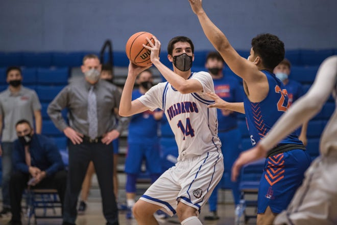 Kaden Self (14) looks to pass as the Las Cruces Bulldawgs face off against the Los Lunas Tigers for a class 5A quarterfinal at LCHS in Las Cruces on Tuesday, May 4, 2021.