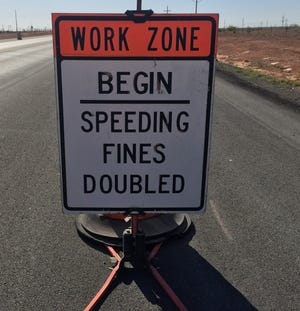 A sign on U.S. 82 east of Artesia reminds drivers to slow down in a work zone.