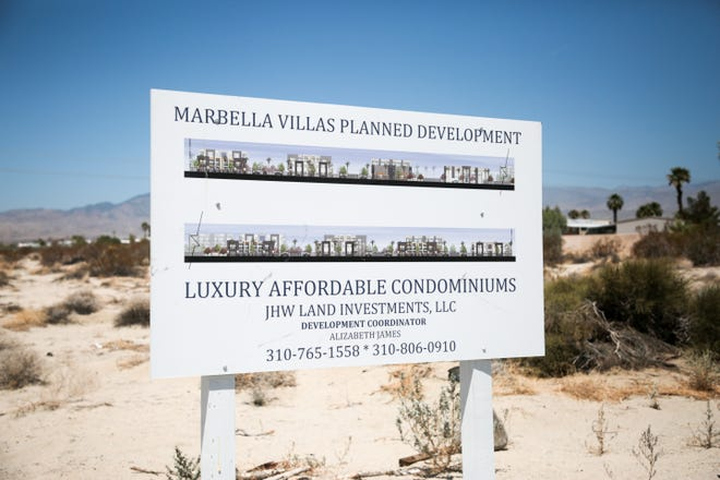A sign for luxury affordable condominiums sits on a vacant lot near Palm Drive and 15th Avenue in Desert Hot Springs, Calif. Desert Hot Springs Planning Commission approved the site for 400 condominiums.