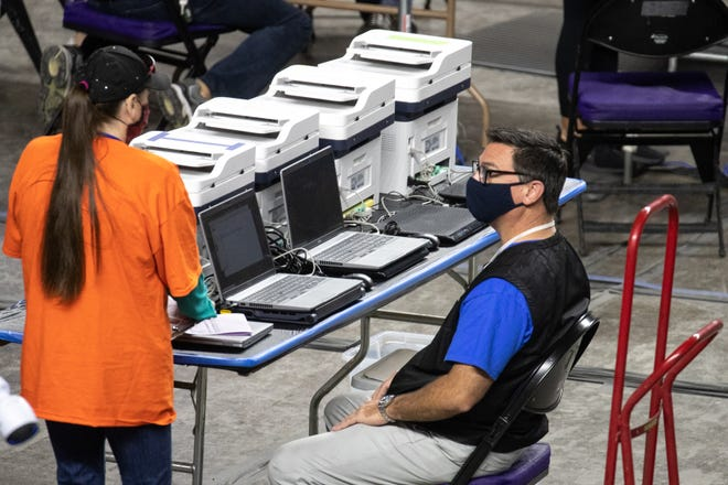 Maricopa County ballots from the 2020 general election are examined and recounted by contractors hired by the Arizona Senate, May 5, 2021, at the Veterans Memorial Coliseum, Phoenix.