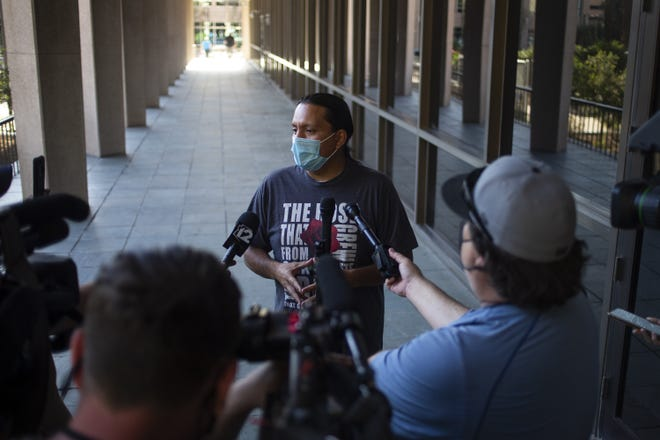Phoenix City Council member and Vice Mayor Carlos Garcia speaks to the press outside a rally calling for defunding the Phoenix Police Department outside City Council chambers on May 4, 2021.