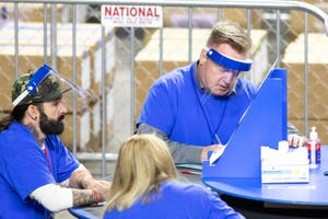 Former Arizona state Rep. Anthony Kern, R-Glendale, recounts ballots from the 2020 general election as a contractor working for Cyber Ninjas, who was hired by the Arizona State Senate at Veterans Memorial Coliseum on May 3, 2021 in Phoenix.