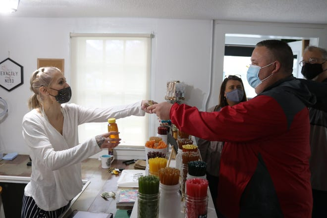 Among the first day of sales for new downtown business owner Ashley Rickey, of The Naked Herb Co., was a jar of natural honey to Mayor Mike Snider.