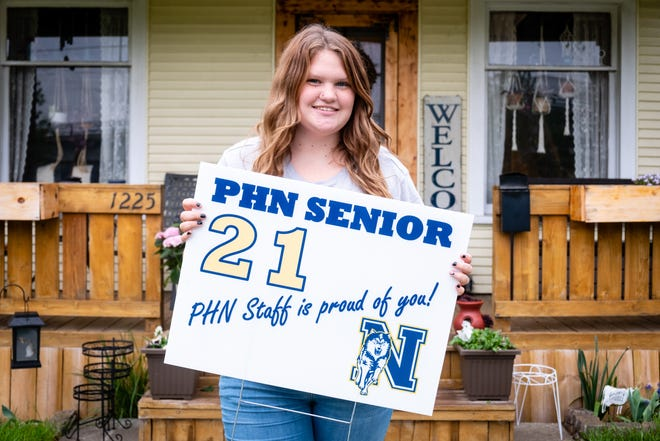 Ali Guenther poses for a portrait Wednesday, May 4, 2021, at her family's Port Huron home. Guenther, a senior at Port Huron Northern, is organizing a senior recognition parade in Port Huron.