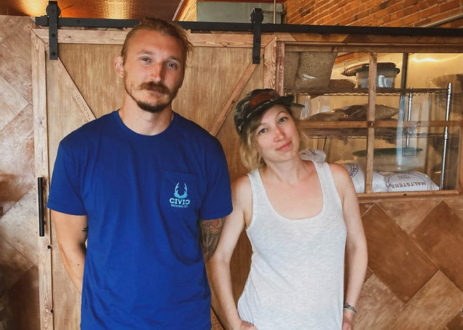Elliot Seidler, left, and big sister Taylor Seidler putting the finishing touches on the Civic Brewing Co. in Sopchoppy this week.