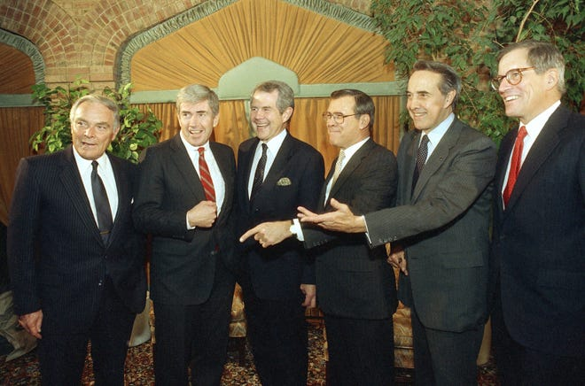 1988 would-be Presidents, from left to right are, Alexander Haig, Rep. Jack Kemp, Pat Robertson, Donald Rumsfeld, Sen. Robert Dole, and Pete du Pont joke around during a picture session on Friday, March 14, 1987 in Nashua, New Hampshire. The presidential hopefuls were guests at the Northeast Republican Leadership conference. (AP Photo/Mark Lennihan)