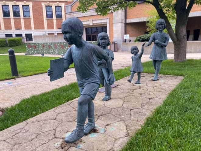 The library children sculptures by Marilyn Westegerdes, installed in 2001, can be found at the entrance of the John McIntire Library.