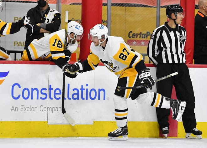 Pittsburgh Penguins center Sidney Crosby celebrates a goal on May 4 with Jason Zucker. The Penguins host the Islanders in their playoff opener Sunday.