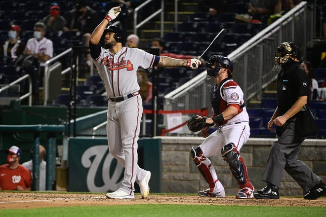 Braves pitcher Huascar Ynoa strikes a pose after hitting a grand slam Tuesday night in Washington.