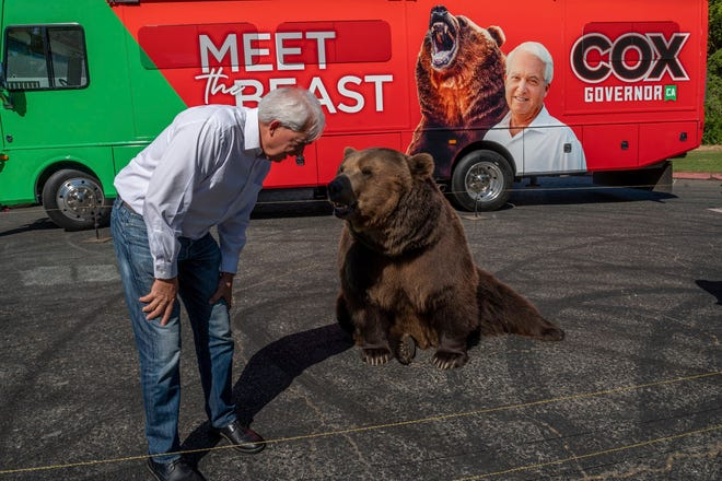 """John Cox, Republican recall candidate for California governor, begins his statewide """"Meet the Beast"""" bus tour on Tuesday, May 4, 2021, with Tag, a Kodiak brown bear, at Miller Regional Park in Sacramento."""