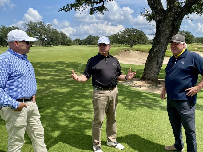 Tom Fazio, center, discusses the details on his soon-to-open Driftwood Golf and Ranch Club.