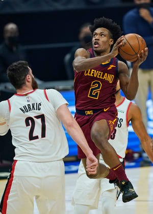 Cavaliers guard Collin Sexton (2) drives to the basket against Portland Trail Blazers forward Jusuf Nurkic (27) during the first half of the Blazers' 141-105 win Wednesday night. [Tony Dejak/Associated Press]