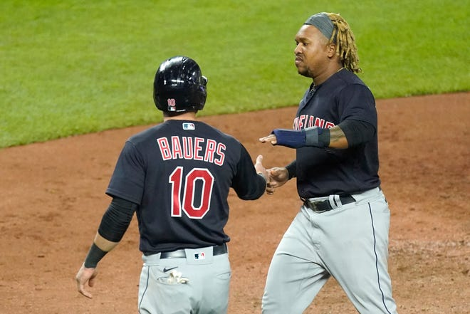 Cleveland's Jake Bauers (10) and Jose Ramirez celebrate after scoring on a two-run double by Eddie Rosario during the sixth inning of 5-4 win over the Kansas City Royals on Wednesday night. [Charlie Riedel/Associated Press]