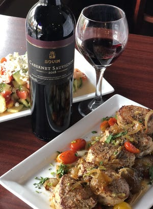 Bovin cabernet from Macedonia is paired with grilled pork medallions April 20 at the Village Gardens in Cuyahoga Falls.