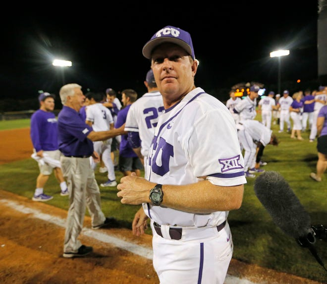 TCU coach Jim Schlossnagle looks around as he team celebrates after the game as TCU defeats Texas A&M 5-4 in 16 innings in the NCAA Division 1 Baseball Super Regional final in Lupton Stadium, Monday, June 8, 2015.