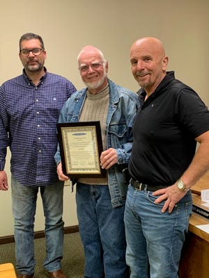 Smith Township trustees David Mannion, right, and Scott Showalter, left, helped honor Ken O'Brock at a May 6 meeting for O'Brock's efforts to construct a pavilion at Township Park.