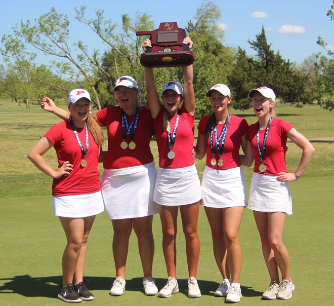 The Lady Indians celebrate with their Class 3A State Championship trophy on Thursday at Westwood Park Golf in Norman.