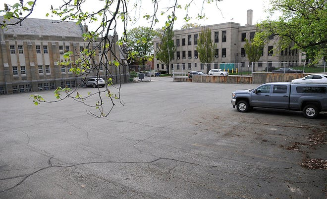 The old Ashland Middle School parking lot is seen here at the corner of E. 3rd Street and Cottage Street on Thursday, May 6, 2021. The county is purchasing the lot to use for parking for the courthouse, seen in the background. TOM E. PUSKAR/TIMES-GAZETTE.COM
