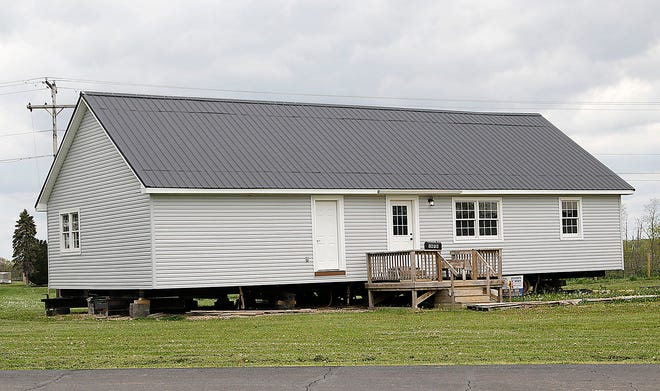 The Career Center construction trades house, which will be auctioned on May 15, was constructed before the hike in the price of construction materials.