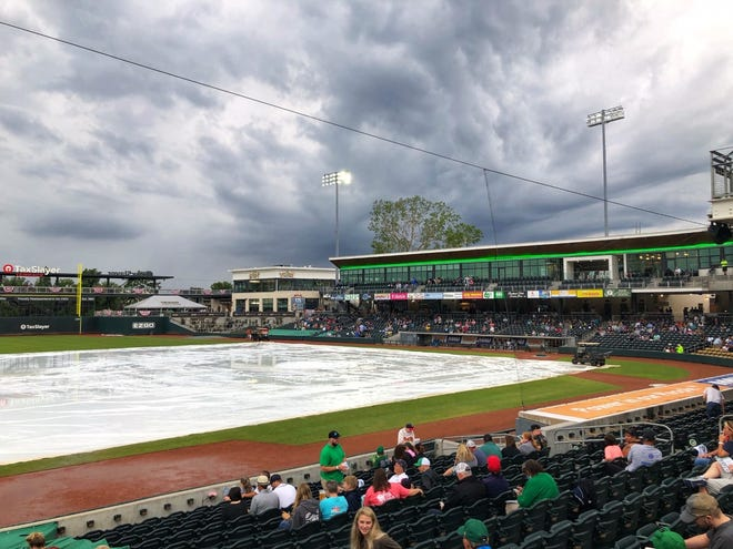 Fans gather in the rain at SRP Park in North Augusta on Tuesday, May 4 for Opening Day. The game was pushed back a day due to weather, which the Augusta GreenJackets defeated the Columbia Fireflies 8-1. (Mike Adams for The Augusta Chronicle)