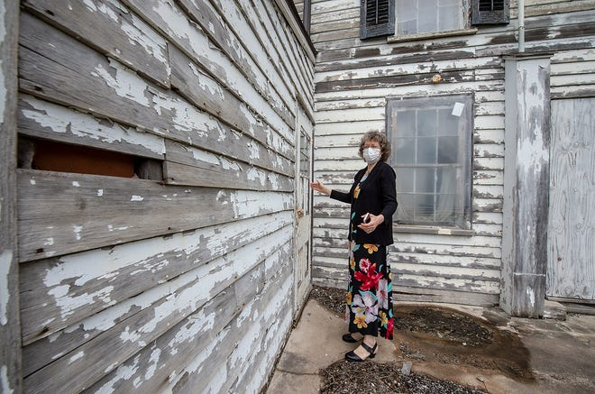 Donna Doan, of Langhorne, Patterson Farm Preservation Corporation board member, points out the settler's cabin building at Satterthwaite, on the Patterson Farm property, in Lower Makefield, on Tuesday, May 4, 2021.