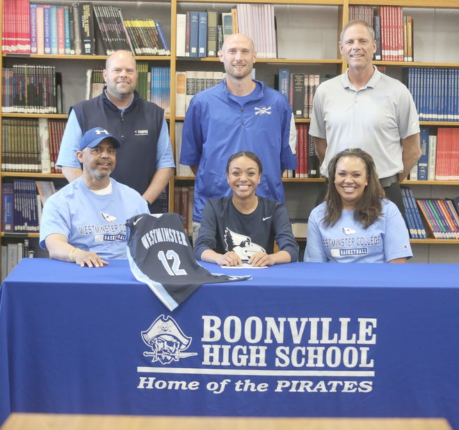 Boonville senior Jodie Bass recently signed a basketball letter of intent with Westminster College in Fulton. On hand during the signing last week at the media center at Boonville High School were (left to right)Jodie Bass, Jodie Bass and Raina Martin. (back row left to right) Boonville Athletic Director Chris Shikles, Boonville girls basketball coach Jaryt Hunzker and Boonville Principal Tim Edwards.