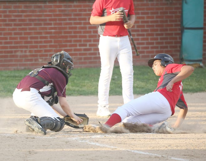 Einspahr Construction catcher Bryce Newham applies the tag on Auto Body Experts' Brenden Perry Monday night in Cal Ripken Major at the Cooper County Baseball Association Ballfield at Harley park.