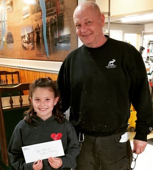 Eight-year-old Kira Christensen and Wagner Restaurant owner John Pallar presented their check for $4,300 to the Hope Walk of Yates County,  knowing that all funds raised in Yates County will stay in Yates County.