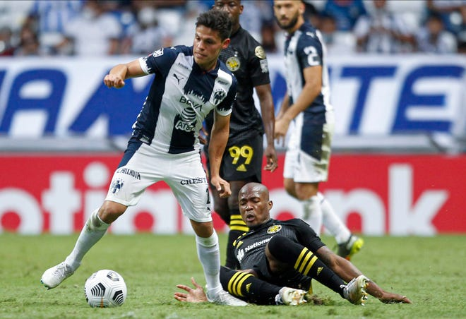Jesus Gallardo of Monterrey dribbles away from the fallen Darlington Nagbe of the Crew on Wednesday. The Crew was outshot 21-6 with just one shot on target compared to 11 for Monterrey.