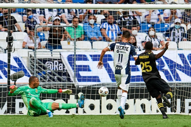 Columbus Crew goalkeeper Eloy Room dives to his right as CF Monterrey midfielder Maxi Mesa scores in a 3-0 loss for the Crew in CONCACAF Champions League on May 5, 2021 in Guadalupe, Nuevo Leon, Mexico.