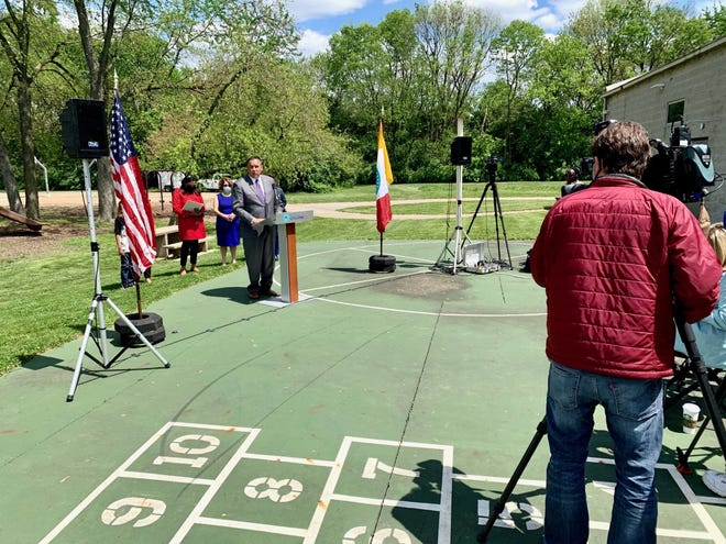 Mayor Andrew J. Ginther hosts a press conference Thursday outside the Driving Park Community Recreation Center announcing Columbus youth summer programs meant to stem violence.