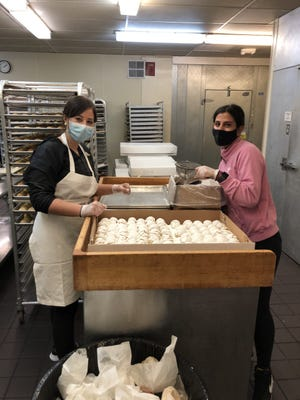 Zabetina Soulas, left, and Melanie Pappas are making kourambiethes for the Taste of Greece Festival.