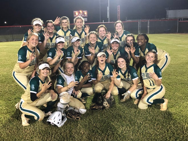 Eastern Randolph's softball team celebrates reaching the third round of the 2-A state playoffs. [Cecil Mock for The Courier-Tribune]