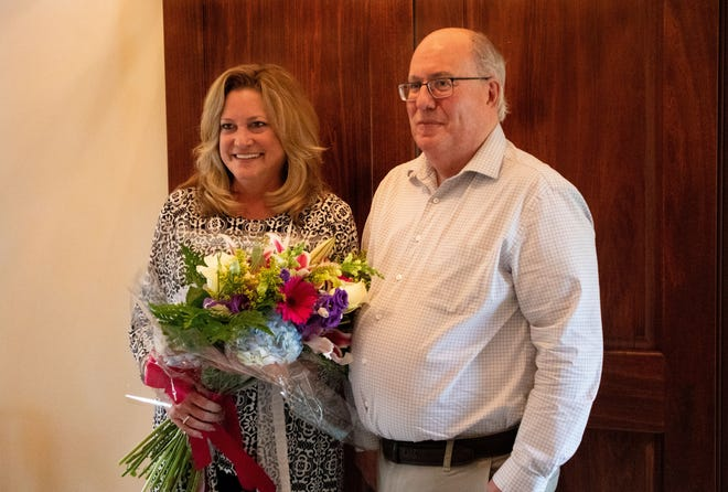 Tom Poulson, the owner of The Bouquet Shop in Orrville, surprised Maribeth Burns at her home with the news of her award.