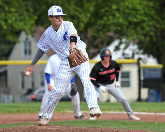 Adrian pitcher Brendan Howard delivers during the Maples' game against SEC White foe Tecumseh on Wednesday.