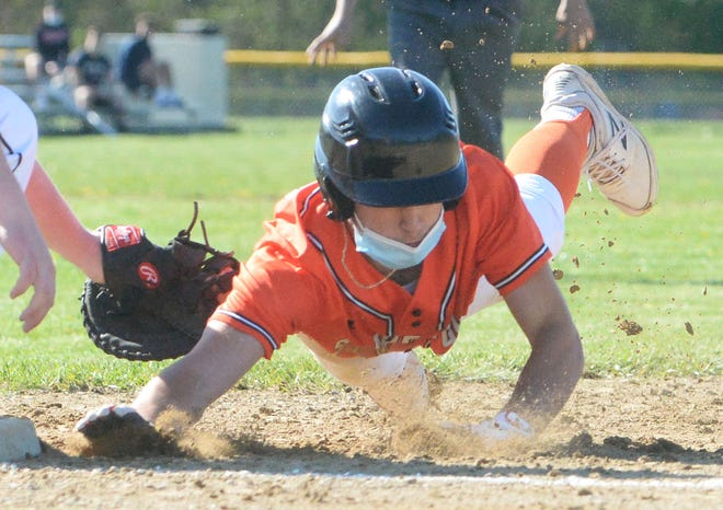 Stoughton runner Ben Zola tries to get back to first base ahead of a pickoff throw by Taunton pitcher Daniel MacDougall during a game on Thursday, May 6, 2021.