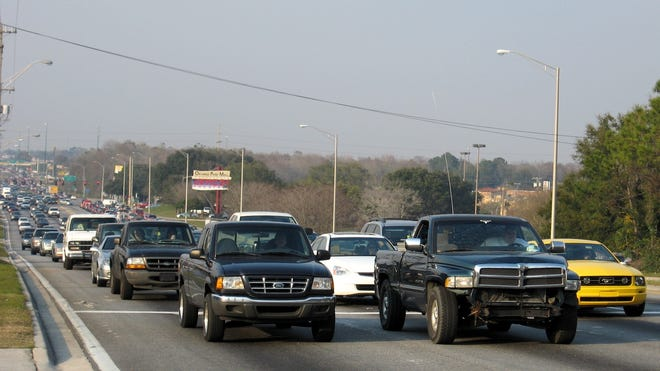 Lines of traffic crawl by the Orange Park Mall on Blanding Boulevard in this file photo.