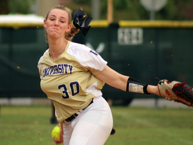 University Christian's Sophia Kardatzke (30) delivers a pitch during pregame warmups in softball regionals. The UC ace began pitching for the varsity squad while still in middle school, a practice that could be in jeopardy if the FHSAA votes to restrict varsity play to ninth grade and up.