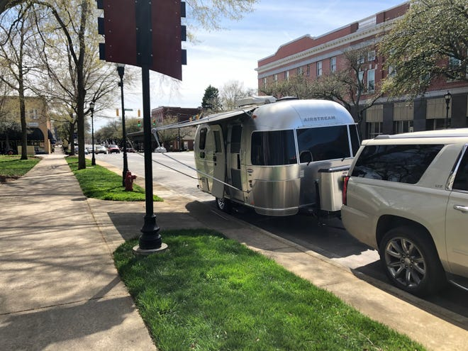 An Airstream owner parks their vehicle in downtown Shelby.