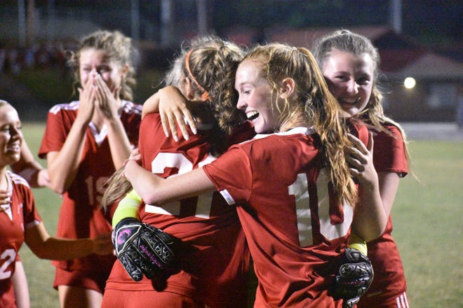 South Point girls soccer players embrace following a heart-stopping 4-3 win in penalty kicks over Fred T. Foard.