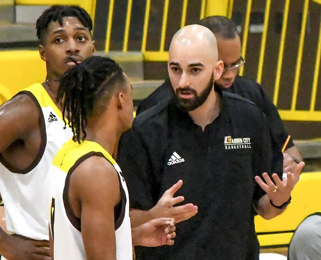 Garden City Community College head basketball coach Cole Dewey talks with his men's basketball team during a game earlier this season. Dewey has resigned from his GCCC coaching job to take an assistant position with Texas A&M Corpus Christi.