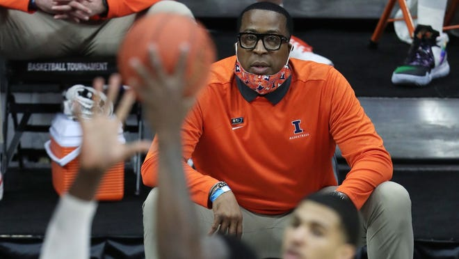 """Illinois assistant coach Ron """"Chin"""" Coleman watches the team play Ohio State in overtime of the Big Ten men's basketball tournament championship game at Lucas Oil Stadium in Indianapolis on March 14, 2021."""