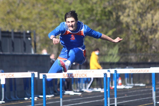 Saugatuck's Benny Diaz leaps over a hurdle during a race