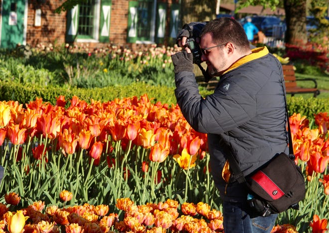 Amateur photographers had the chance to learn from professionals Heidi Quellet and Kathy Odiorne during the Tulip Time Photo Walk Wednesday, May 5, at Windmill Island.