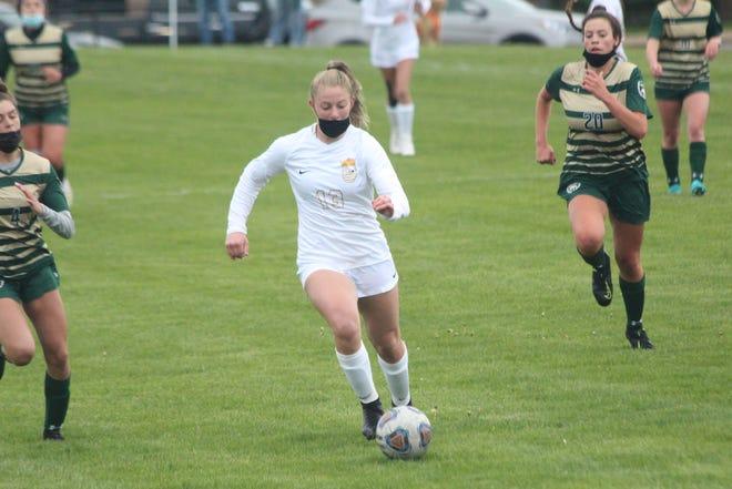 Zeeland East's Paige Westra gets behind the Zeeland West defense
